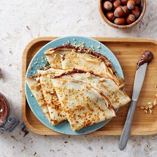 MeniuFamilie.ro by Elegant Catering - Pancakes asortate cu toping-uri Nutela și cocos, Nutela și banane, dulceață de prune, dulceață de afine 500g